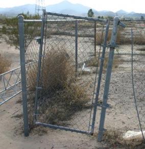Gate held closed by weeds